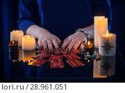 Купить «divination with cards and candles», фото № 28961051, снято 30 марта 2018 г. (c) Майя Крученкова / Фотобанк Лори