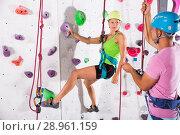 Купить «Сouple in climbing outfit training at gym», фото № 28961159, снято 20 октября 2018 г. (c) Яков Филимонов / Фотобанк Лори
