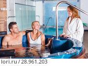 Купить «Woman with man are talking in pool», фото № 28961203, снято 18 июля 2017 г. (c) Яков Филимонов / Фотобанк Лори