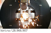 Купить «The equipment cuts cylindrical metal, sparks fly from laser», видеоролик № 28966907, снято 16 июля 2019 г. (c) Константин Шишкин / Фотобанк Лори
