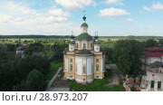 Купить «Cathedral of the Ascension of the Lord. Spaso-Sumorin Monastery. Totma. Vologda Region. Russia. view from above», видеоролик № 28973207, снято 16 августа 2018 г. (c) Mikhail Starodubov / Фотобанк Лори