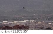 Купить «Gull flying over the town», видеоролик № 28973551, снято 18 июня 2018 г. (c) Данил Руденко / Фотобанк Лори