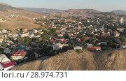 Купить «Aerial view Village in Crimea», видеоролик № 28974731, снято 20 июля 2018 г. (c) Илья Шаматура / Фотобанк Лори