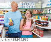 Купить «Preteen girl with father holding different goods in supermarket», фото № 28975983, снято 4 июля 2018 г. (c) Яков Филимонов / Фотобанк Лори