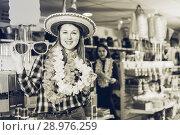Купить «Girl joking in festive accessories shop», фото № 28976259, снято 15 марта 2018 г. (c) Яков Филимонов / Фотобанк Лори