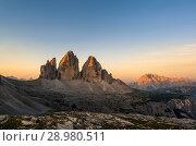 Купить «Tre Cime di Lavaredo at sunrise, Tre Cime Natural Park, Dolomites, South Tyrol, Italy», фото № 28980511, снято 31 августа 2017 г. (c) age Fotostock / Фотобанк Лори