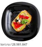 Купить «Top view of sandwich with guacamole, canned fish, pepper on black plate», фото № 28981847, снято 22 июня 2018 г. (c) Яков Филимонов / Фотобанк Лори