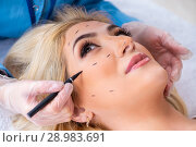 Купить «The woman getting ready for plastic surgery», фото № 28983691, снято 13 апреля 2018 г. (c) Elnur / Фотобанк Лори