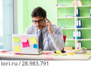 Купить «Young help desk operator working in office with many conflicting», фото № 28983791, снято 18 мая 2018 г. (c) Elnur / Фотобанк Лори