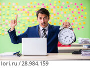 Купить «Businessman with many conflicting priorities in time management», фото № 28984159, снято 23 мая 2018 г. (c) Elnur / Фотобанк Лори