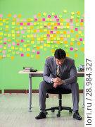 Купить «The businessman with many conflicting priorities», фото № 28984327, снято 24 мая 2018 г. (c) Elnur / Фотобанк Лори