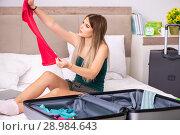 Купить «The young woman getting ready for summer vacation», фото № 28984643, снято 29 июня 2018 г. (c) Elnur / Фотобанк Лори