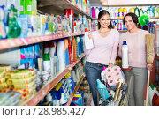 Купить «Young girl and mature woman choosing washing detergent», фото № 28985427, снято 9 декабря 2019 г. (c) Яков Филимонов / Фотобанк Лори