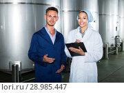 two workers in coats on winery manufactory. Стоковое фото, фотограф Яков Филимонов / Фотобанк Лори