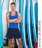 Купить «Happy guy surfer posing with surfboard», фото № 28985643, снято 30 апреля 2018 г. (c) Яков Филимонов / Фотобанк Лори