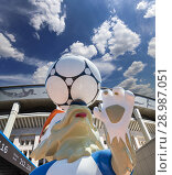 Official mascot of the 2018 FIFA World Cup in Russia-- wolf Zabivaka and Luzhniki Olympic Complex -- Stadium for the 2018 FIFA World Cup. Moscow. Редакционное фото, фотограф Владимир Журавлев / Фотобанк Лори