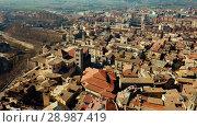 Купить «Aerial view of historic centre of Spanish town of Vic, Catalonia», видеоролик № 28987419, снято 6 марта 2018 г. (c) Яков Филимонов / Фотобанк Лори