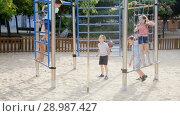 Купить «Glad children playing at the playground», видеоролик № 28987427, снято 23 июля 2018 г. (c) Яков Филимонов / Фотобанк Лори