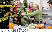 Купить «Happy family is celebrating New Year together and meeting in hallway at home.», видеоролик № 28987639, снято 17 января 2018 г. (c) Яков Филимонов / Фотобанк Лори