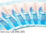 Купить «Двухтысячные купюры», эксклюзивное фото № 28990355, снято 19 августа 2018 г. (c) Dmitry29 / Фотобанк Лори