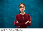Купить «Beautiful young woman posing in studio», фото № 28991055, снято 8 декабря 2017 г. (c) Pavel Biryukov / Фотобанк Лори