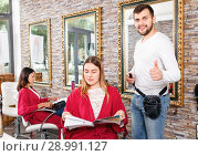 Купить «Portrait of man professional hairdresser near woman client with magazine in salon», фото № 28991127, снято 25 апреля 2018 г. (c) Яков Филимонов / Фотобанк Лори