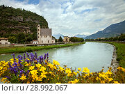 St Apollinare church and Adige river in Trento, Italy (2018 год). Стоковое фото, фотограф Юлия Кузнецова / Фотобанк Лори
