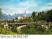 Belluno, Italy - JUL 05, 2018: View of Belluno and ponte Ponte della Vittoria. Редакционное фото, фотограф Юлия Кузнецова / Фотобанк Лори