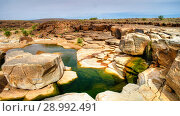 Купить «Panorama of rocky pond on Adrar plateau, Mauritania», фото № 28992491, снято 12 ноября 2012 г. (c) Сергей Майоров / Фотобанк Лори