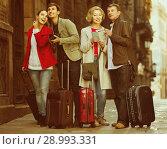 Купить «Portrait of tourists with map and baggage seeing the sights in European city», фото № 28993331, снято 21 октября 2018 г. (c) Яков Филимонов / Фотобанк Лори