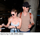 Купить «LeAnn Rimes with her husband Eddie Cibrian at Los Angeles International Airport (LAX) Featuring: LeAnn Rimes, Eddie Cibrian Where: Los Angeles, California...», фото № 28995083, снято 26 апреля 2017 г. (c) age Fotostock / Фотобанк Лори