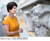Купить «Portrait of woman traveler looking at antiquity sculptures», фото № 29004903, снято 22 октября 2017 г. (c) Яков Филимонов / Фотобанк Лори