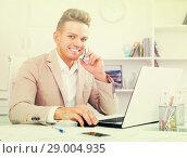 Купить «Man having mobile conversation», фото № 29004935, снято 14 декабря 2019 г. (c) Яков Филимонов / Фотобанк Лори