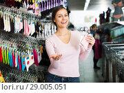 Купить «Woman shopping socks in leg-wear», фото № 29005051, снято 20 октября 2018 г. (c) Яков Филимонов / Фотобанк Лори