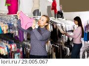 Female customer holding panties in hands. Стоковое фото, фотограф Яков Филимонов / Фотобанк Лори