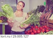Portrait of woman shopping fresh green celery, leek and lettuce. Стоковое фото, фотограф Яков Филимонов / Фотобанк Лори