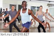 Купить «People dancing lindy hop during group training», фото № 29010827, снято 30 июля 2018 г. (c) Яков Филимонов / Фотобанк Лори