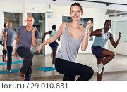 Купить «People dancing lindy hop during group training», фото № 29010831, снято 30 июля 2018 г. (c) Яков Филимонов / Фотобанк Лори