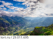 Купить «Panoramic view of Vardzia cave city-monastery. Vardzia is located in the Erusheti Mountain», фото № 29011695, снято 26 июня 2019 г. (c) Mikhail Starodubov / Фотобанк Лори