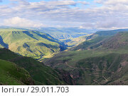 Купить «Panoramic view of the highland in the valley of the river Kura from the height of the hill», фото № 29011703, снято 24 января 2019 г. (c) Mikhail Starodubov / Фотобанк Лори
