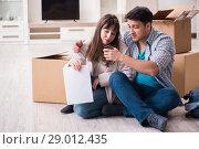 Купить «Young couple receiving foreclosure notice letter», фото № 29012435, снято 23 марта 2018 г. (c) Elnur / Фотобанк Лори