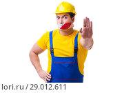Купить «Funny worker wearing coveralls with tape», фото № 29012611, снято 27 марта 2017 г. (c) Elnur / Фотобанк Лори