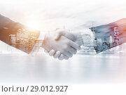 Купить «Concept of cooperation with handshake», фото № 29012927, снято 23 августа 2019 г. (c) Elnur / Фотобанк Лори