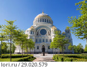 Купить «Sea Cathedral of St. Nicholas with a monument to the famous Russian admiral Fyodor Ushakov in the foreground in Kronstadt, St. Petersburg, Russia», фото № 29020579, снято 25 мая 2018 г. (c) Наталья Волкова / Фотобанк Лори
