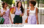 Купить «women with shopping bags and drinks in city», видеоролик № 29020627, снято 15 августа 2018 г. (c) Syda Productions / Фотобанк Лори