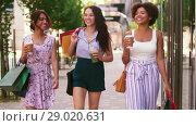 Купить «women with shopping bags and drinks in city», видеоролик № 29020631, снято 15 августа 2018 г. (c) Syda Productions / Фотобанк Лори
