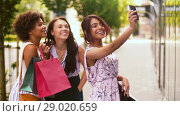 Купить «women with shopping bags taking selfie in city», видеоролик № 29020659, снято 15 августа 2018 г. (c) Syda Productions / Фотобанк Лори