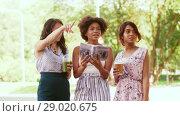 Купить «women with city guide and drinks on street», видеоролик № 29020675, снято 15 августа 2018 г. (c) Syda Productions / Фотобанк Лори