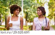 Купить «happy women or friends walking along summer park», видеоролик № 29020691, снято 15 августа 2018 г. (c) Syda Productions / Фотобанк Лори