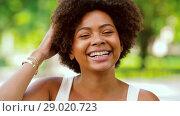 Купить «happy african american young woman outdoors», видеоролик № 29020723, снято 15 августа 2018 г. (c) Syda Productions / Фотобанк Лори